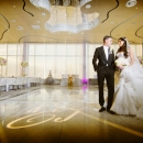 Photo Of Bride And Groom At Wedding Reception - Above Weddings