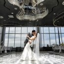 Photo Of Bride And Groom Kissing At Wedding Reception - Above Weddings